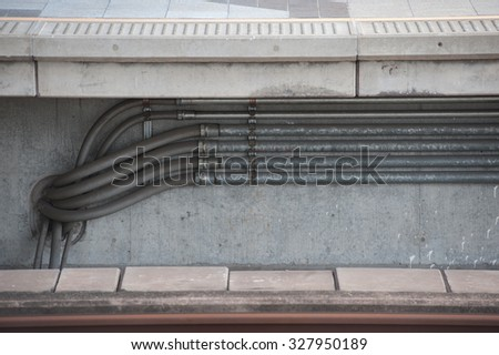 pipes on cement wall / abstract grungy background stock photo