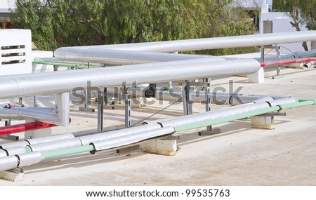 Pipes on Lanzarote hotel rooftop #99535763