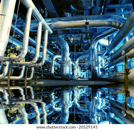 Pipes, tubes, machinery and steam turbine at a power plant #20529143