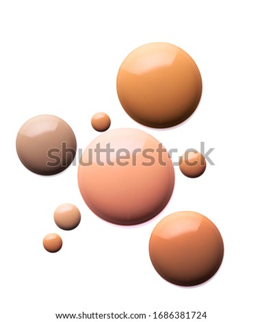 Pipette drops of liquid make-up foundation fluide texture