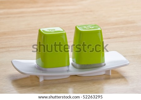 Pipper and salt dispenser kept on a wodden table