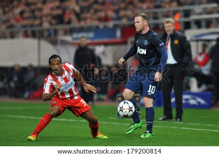 PIRAEUS, GREECE -FEB. 25. Wayne Rooney of Manchester United (R) and Leandro Salino (L) during the match between Olympiacos FC and Manchester United (2-0) at Karaiskakis Stadium on February 25, 2014