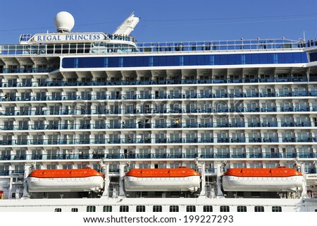 PIRAEUS, GREECE -MAY 27, 2014.  Safety lifeboats and passenger cabins of cruise ship Regal Princess. Ship was built in 2014 and has a capacity of 3560 passengers and 1346 crew.