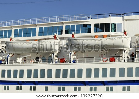 PIRAEUS, GREECE -MAY 27, 2014.  Safety lifeboats and passengers cabins of cruise ship Golden Iris Ship was built in 1975 and has a capacity of 959 passengers and 350 crew.