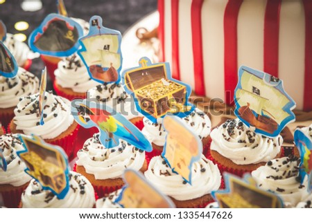 Pirate cupcakes kids birthday party treasure chest cupcakes with white vanilla icing and red paper with picture toppers decorations
