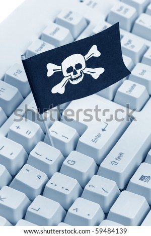 Pirate Flag and Computer Keyboard, concept of Computer Hacker