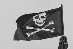 Pirate flag, black and white skull and bones, Jolly Roger.