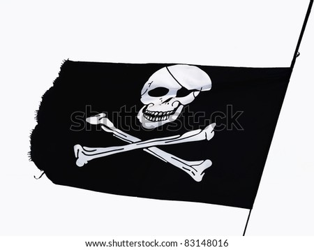 Pirate Flag flying on a white background - stock photo