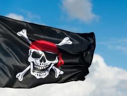 Pirate flag waving on sky