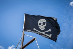 Pirate flag with blue sky skull and crossbones