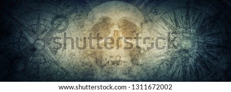 Pirate skull and compasses on old grunge paper background. Retro style. Science, travel, vintage background. History and geography team.