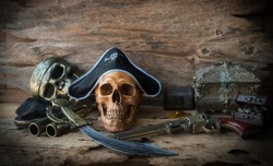 pirate skull or skeleton human on wood background , still life concept