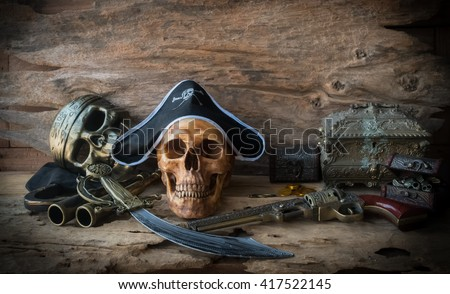 pirate skull or skeleton human on wood background , still life concept