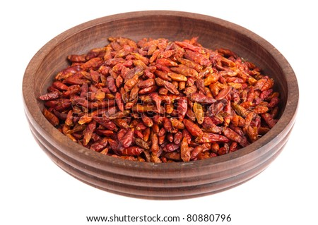 Piri Piri peppers on a vintage wooden bowl (isolated on white background)