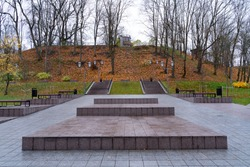 Pirosmani park located in Tartu city center. Empty  park in autumn colours. No people - covid season. Trees have no leaves. Steps and stairs. Empty benches. Cold autumn vibes