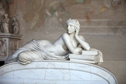 Pisa Campo Santo: Detail from Tomb of Ottaviano Fabrizio Mossotti (1791 - 1863), italian mathematician, physicist and astronomer. The reclining figure represents the Science.