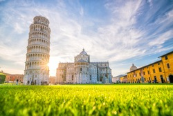 Pisa Cathedral and the Leaning Tower in a sunny day in Pisa, Italy.