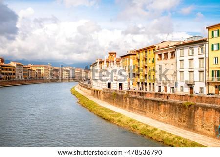 Pisa cityscape view on Arno river with Santa Maria Della Spina church in Italy #478536790