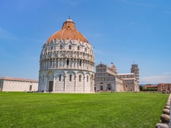 Pisa, historic center. Famous UNESCO complex, San Giovanni or St. John Baptistery, Cathedral or Duomo di Santa Maria Assunta and famous Leaning Tower of Pisa or campanile. View of Piazza dei Miracoli.