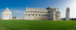 Pisa, Italiy - leaning tower, cathedral and baptistery panorama on a bright sunny day