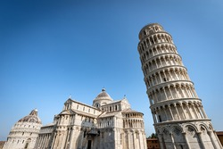 Pisa, Piazza dei Miracoli (Square of Miracles), Leaning Tower, the Cathedral (Duomo of Santa Maria Assunta) and the Baptistery (Battistero di San Giovanni). UNESCO heritage site, Tuscany, Italy.