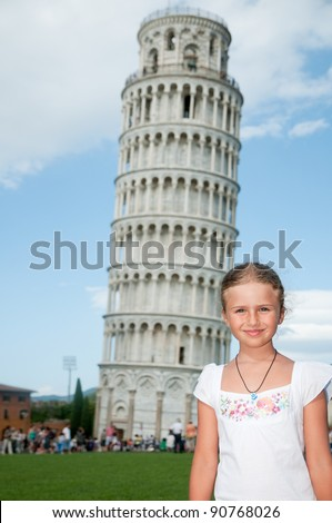 Pisa - travel to famous places in Europe, portrait of beautiful girl, in background the Leaning Tower in Pisa, Italy