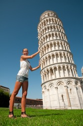 Pisa - travel to famous places in Europe, young girl and the Leaning Tower in Pisa, Italy