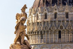 Pisa, Tuscany, Italy - Old town view with Cathedral, tower and batipstery in a sunny day