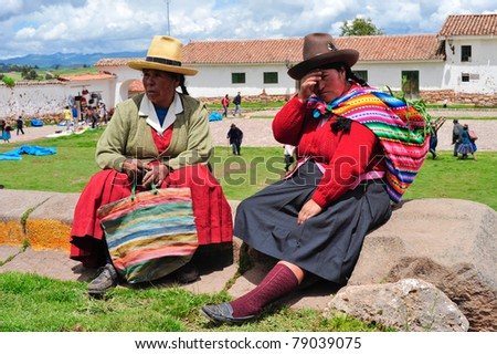 PISAC, PERU, SOUTH AMERICA - MARCH 07: Tired women are taking brake before sunday mess on March 07, 2010 in Pisac, peru, south america.
