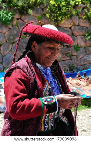 PISAC, PERU, SOUTH AMERICA - MARCH 07: Woman is presenting her souvenirs on sunday market in Pisac on March 07 2010 in Pisac, peru, south america.