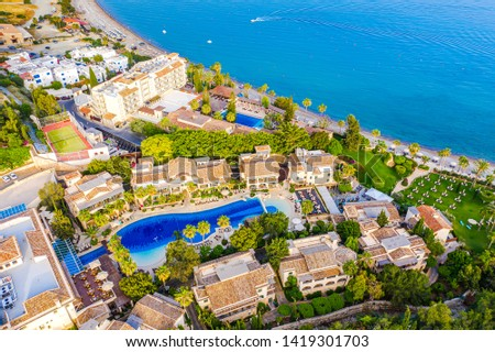 Pissouri. Cyprus Republic. Pissouri village, sunny day top panorama from a drone.  Some resort hotels with pools on the Mediterranean sea coast. The Pissouri spa resorts. Hotel rest in Cyprus. #1419301703