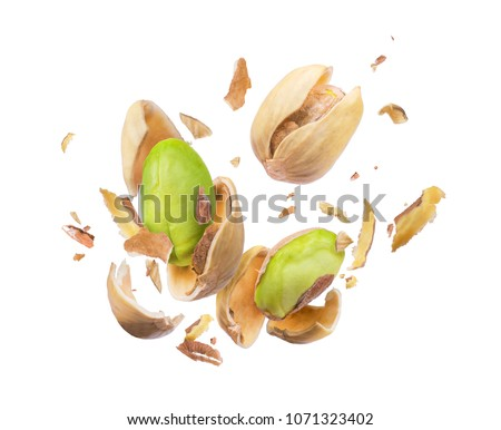 Pistachio crushed in the air close-up isolated on white background