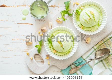 Pistachio ice cream in white bowl