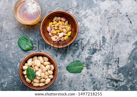 Pistachio nuts,healthy snacks.Salted pistachios for beer.Pistachio nuts in the bowl #1497218255
