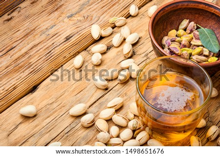 Pistachio nuts,healthy snacks.Salted pistachios for beer.Pistachio nuts in the bowl #1498651676