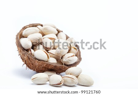 Pistachio nuts in the shell of the coconut.