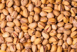 Pistachio texture. Nuts. Roasted salted pistachio nuts healthy delicious food studio photo.
