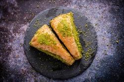 Pistachio Turkish Baklava  Havuc Dilimi. Traditional Turkish Dessert. Walnut, Pistachio Turkish Style Antep Baklava. Baklava from Turkish cuisine.