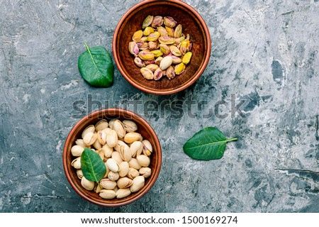 Pistachio with leaf.Dish full of pistachios.Nut.Pistachio in nutshell #1500169274