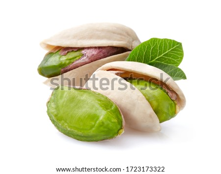 Pistachio with leaves in closeup