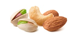 Pistachios, almonds and cashew nuts mix isolated on white background. Package design element with clipping path