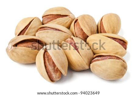 pistachios heap against white background