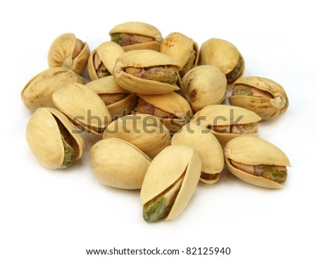 Pistachios isolated over white background