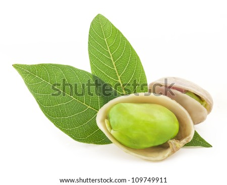 Pistachios nuts with a leaf, isolated on white background - stock photo