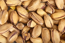 Pistachios. Pistachios on a white background. California pistachios. Pistachio texture. Macro photography of pistachios.