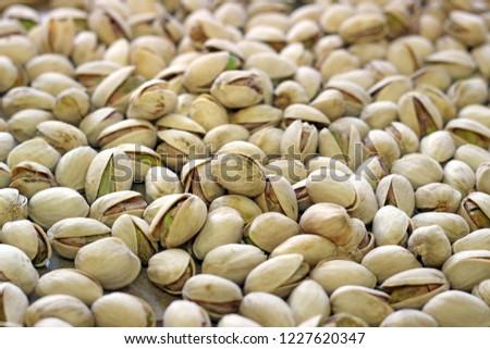 Pistachios. Salted pistachios. Pistachios in shell. pistachios close up. Pistachio background. #1227620347