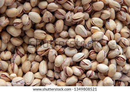 Pistachios. Salted pistachios. Pistachios in shell. pistachios close up. Pistachio background #1349808521