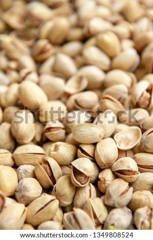 Pistachios. Salted pistachios. Pistachios in shell. pistachios close up. Pistachio background #1349808524