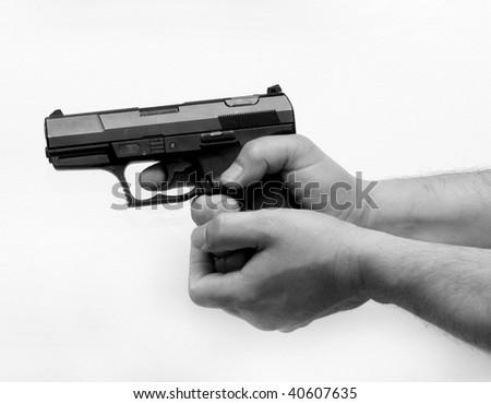 Pistol in hand - stock photo