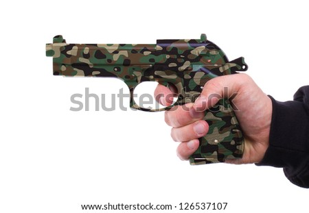 Pistol in hand, isolated on white background, camouflage